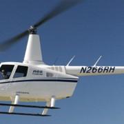 Вертолеты. Вертолет с газотурбинным двигателем Robinson.Вертолет R66 Turbine Helicopter фото
