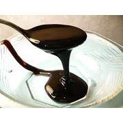 Меласса-сиропообразная жидкость тёмно-бурого цвета со специфическим запахом фото