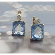 Золотые серьги с топазами и бриллиантами. фото