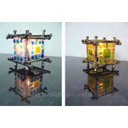 Кованый подсвечник с использованием цветного стекла. фото