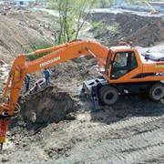 Услуги подряда по землеройным работам фото