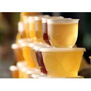 Упаковка мёда в пластиковые стаканчики по 20 150250 и400гр. фото