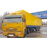 Доставка грузов двумя автомобилями КАМАЗ с бортовыми прицепами до 26 т грузоподъемностью каждый фото