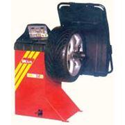 Станок балансировки колес легковых автомобилей вэнов джипов с весомдо 60 кг и шириной до 13 фото