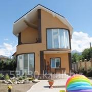 Дом отделаный фасадными панелями ИДЕАЛ вид 2 фото