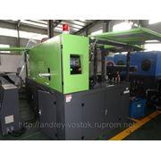Автомат выдува пэт тары производительностью 2000 бвч гидравлическое смыкание прессформы на два гнезда фото