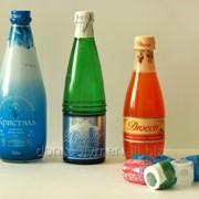 Термоусадочные колпачки на бутылки с пивом и лимонадом фото