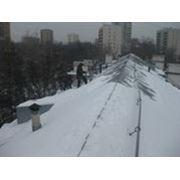 Уборка снега и наледи с крыш фото