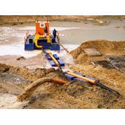 Добыча песка при помощи земснарядов фото