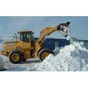 Уборка снега погрузчиком фото