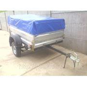 Прицеп легковой. Кузов размером 1,9*1,25 м. С двойным бортом с тентом высотой 0,9м. фото