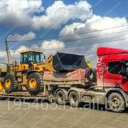 Перевозка спецтехники по России фото