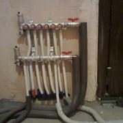 установка замена ремонт коллектора отопления. фото