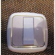 Выключатель внутренний тройной с золотой оконтовкой фото