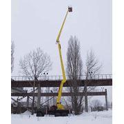 Подъёмник гидравлический ПГ-28 для подъёма рабочих с инструментом и приспособлениями при выполнении строительно-монтажных и эксплуатационно-ремонтных работ на высоковольтных линиях электропередач и связи фото