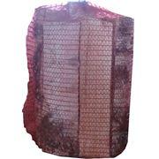 Дрова березовые колотые упакованные в сетки. фото