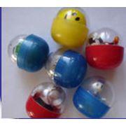 Игрушки детские в капсуле 54 мм фото