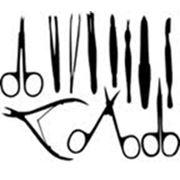 Алмазная заточка парикмахерского кухонного портновского инструмента на профессиональном оборудовании. фото