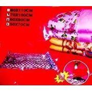 Вакуумные пакеты с насосом для хранения одежды фото