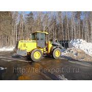Погрузка с вывозом и утилизацией снега фото