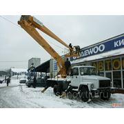 Сброс снега с крыш с помощью автовышки - 18 метров фото