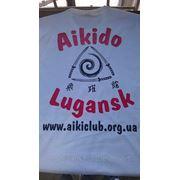 Нанесение логотипов на футболки фото
