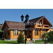 Срубы домов из рубленного оцилиндрованного бревна из Вологды. фото
