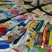 Фасовка продуктов питания в порционную упаковку. фото
