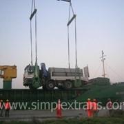 Перевозка колесной техники (тягачей, тракторов) фото