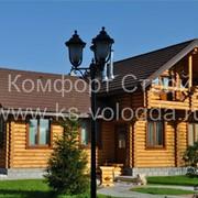 Срубы домов из рубленного, оцилиндрованного бревна из Вологды. фото