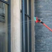 Мытье окон, остекления фасадов до 25 м. высоту фото