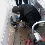 Прочистка труб канализации. фото