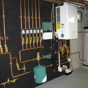 Монтаж газовых котлов, системы отопления и горячего водоснабжения. фото