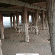 Работы по устройству деревянных свайных фундаментов фото