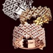Кольца из различного золота с драгоценными камнями фото