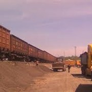 Перевалка (перегрузка)грузов, хранение на открытых площадках и в складских помещениях. фотография