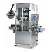 Автомат для нанесения термоусадочных этикеток. фото