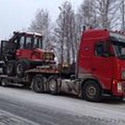 Перевозка спецтехники тралами ( низкорамники ) по России фото