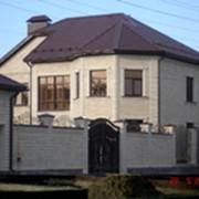 Отделка фасада дома природным камнем фото