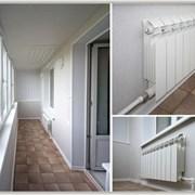 Радиатор отопления на балконе фотография