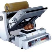 Полуавтоматическая упаковочная машина фото