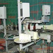 Этикетировочный двухпозиционный автомат фото