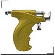 Пистолет для прокола мочки уха фото