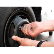 Балансировка колес услуги по ремонту шин фото