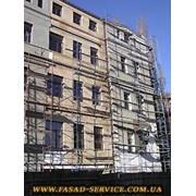 Утепление и облицовка фасадов зданий. фото