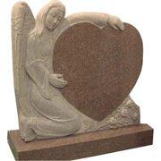 Памятники и украшения надгробные из камня фотография
