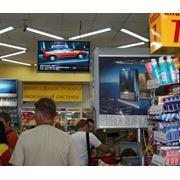 Реклама на мониторах в сети магазинов фото