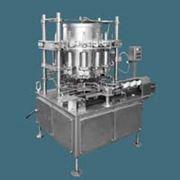 Машина для наполнения соусами и заливами плодоовощной продукции в металлические консервные банки фото