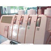 Машина швейная для обметывания кромок фото