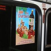 Реклама на стикерах внутри общественного транспорта фото